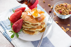 Breakfast: pancakes with maple syrup and strawberries Stock Photo