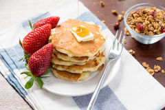 Breakfast: pancakes with maple syrup and strawberries Stock Images