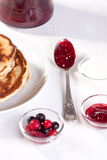 Breakfast with pancakes and strawberries jam Royalty Free Stock Photos