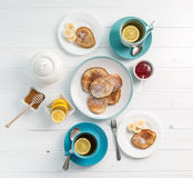 Breakfast with pancakes, tea with lemon, topview Stock Photo