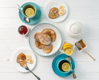 Breakfast with pancakes, tea with lemon, topview Royalty Free Stock Image