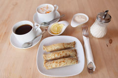 Breakfast with pancakes and yoghurt Royalty Free Stock Photos