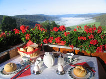 Breakfast in paradise. High above in a mountain appartement Stock Photos
