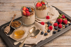 Breakfast parfait with homemade granola, fresh fruits and yogurt Royalty Free Stock Photo