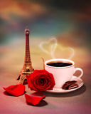 Breakfast in Paris. Photo of breakfast in Paris, beautiful morning in France, romantic still life, cup of coffee with piece of chocolate and fresh red rose on Stock Images