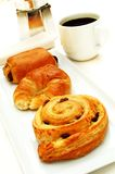 Breakfast pastries with coffee Stock Images