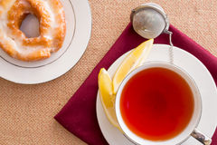 Breakfast with pastries, and hot tea with lemon. Royalty Free Stock Image
