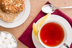Breakfast with pastries, and hot tea with lemon. Royalty Free Stock Photos