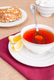 Breakfast with pastries, and hot tea with lemon. Stock Image