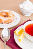 Breakfast with pastries, and hot tea with lemon. Stock Photos