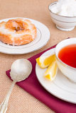 Breakfast with pastries, and hot tea with lemon. Royalty Free Stock Images