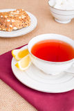 Breakfast with pastries, and hot tea with lemon. Royalty Free Stock Photography