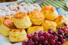 Breakfast pastry muffin at Spring Festival. Breakfast pastry muffin scone and grapes at Spring Festival picnic event Stock Photo