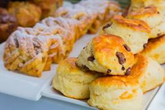 Breakfast pastry scone muffin at Spring Festival. Breakfast pastry scone and dusted Danish pastry at Spring Festival picnic event Stock Image