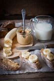 Breakfast - peanut butter, banana, milk Stock Images