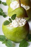 Breakfast: pears with cottage cheese and mint vertical Royalty Free Stock Photography