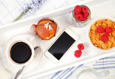 Breakfast and phone Stock Photography