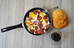 Breakfast pictures of sausage egg in frying pan Stock Photos