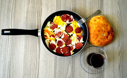 Breakfast pictures of sausage egg in frying pan Stock Photography