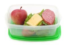 Breakfast in a plastic container. Breakfast in a plastic container on a white background Stock Photos