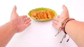 Breakfast in a plate with male hands pointed at it stock image