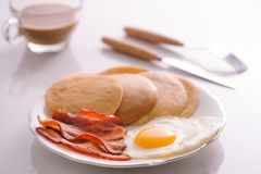 Breakfast plate with pancakes, eggs, bacon and fruit. Stock Image