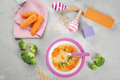 Breakfast with plate of tasty soup for baby Royalty Free Stock Photo