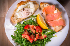 Breakfast plate with two crossants with egg and salmon Stock Photo