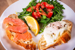 Breakfast plate with two crossants with egg and salmon Royalty Free Stock Images