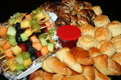 Breakfast platter. A food platter with scones, croissants and fruit kebabs Stock Image