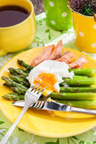 Breakfast with poached egg and green asparagus Stock Photo