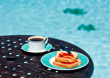 Breakfast by the pool on sunny day Royalty Free Stock Photo