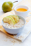 Breakfast with porridge. Porridge with apple and orange juice Stock Photos