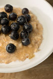 Breakfast Porridge, Blueberry Oatmeal on Wooden Background Royalty Free Stock Photography
