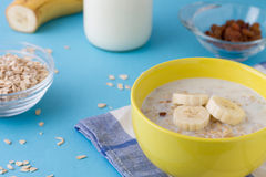 Breakfast porridge Breakfast porridge with bananas and raisins Royalty Free Stock Photos