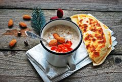 Breakfast porridge oatmeal with dried fruits and nuts Stock Photo
