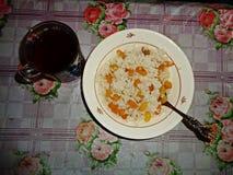 Breakfast - porridge. Rice porridge with raisins - the most it for fitness Stock Photos