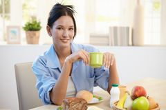 Breakfast portrait of young woman Royalty Free Stock Image