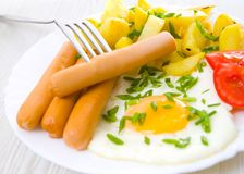 Breakfast. potato, egg and sausage Royalty Free Stock Images
