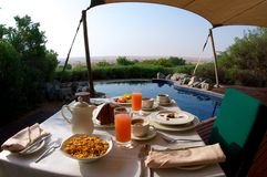 Breakfast on a private pool in the desert Stock Photo