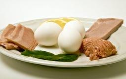 Breakfast Protiens. Eggs, turkey bacon, ground chicken and lean ham as healthier alternatives for breakfast proteins Stock Photo