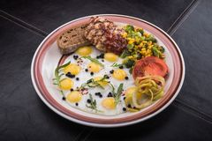 Breakfast of quail eggs with tomatoes, chicken fillet Stock Photo