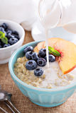 Breakfast quinoa porridge with fresh fruits Stock Photography