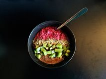 Breakfast: Raspberry chia bowl with kiwifruit, hemp seeds, hazelnut butter. A healthy raspberry chia bowl (raspberries mixed with chia seeds and almond milk) is Stock Image
