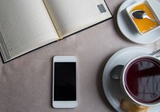 Breakfast in restaurant. Business breakfast, tea and honey,diary and news stock images