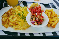 Breakfast in restaurant with omelet, salad and french fries in instagram style Royalty Free Stock Photo