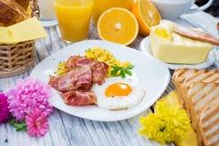 Breakfast. Rich Breakfast on wooden background Stock Photos