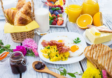 Breakfast. Rich Breakfast on wooden background Royalty Free Stock Photos