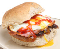Breakfast Roll with Egg, Bacon and Sausages Stock Photos