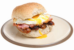 Breakfast Roll with Sausage, Bacon and Egg Stock Photo